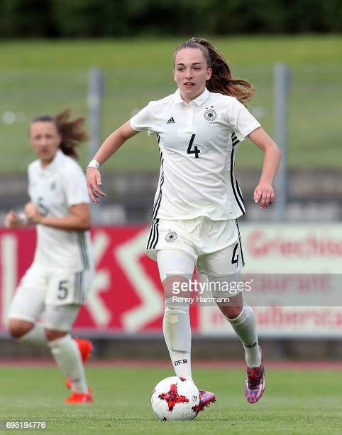Sophia Kleinherne of Germany runs with the ball during the U19 women's elite round match between Germany and Switzerland at Friedensstadion on June 9...
