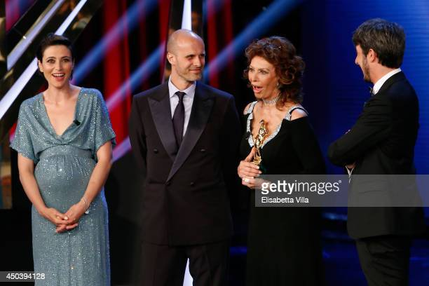 Sophia Loren and Edoardo Ponti receive a special award for 'Human Voice' as they attend the David Di Donatello Awards Ceremony at the Dear Studios on...
