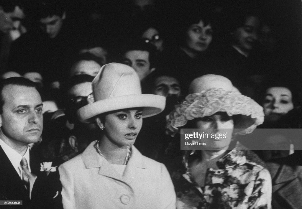Sophia Loren (2L) and Mrs. Romilda Villani, attending the wedding of Romano Mussolini to Maria Scicolone.