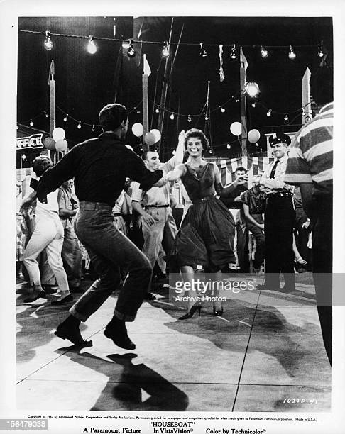 Sophia Loren dances with a man in a scene from the film 'Houseboat' 1958