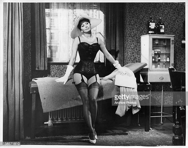 Sophia Loren does a stripe tease down to her undergarments for Peter Sellers in a scene from the film 'The Millionairess' 1960