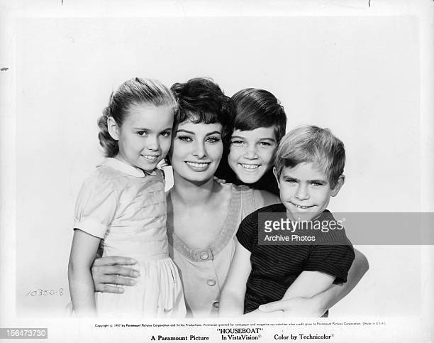 Sophia Loren in a group photograph with three children in a scene from the film 'Houseboat' 1958