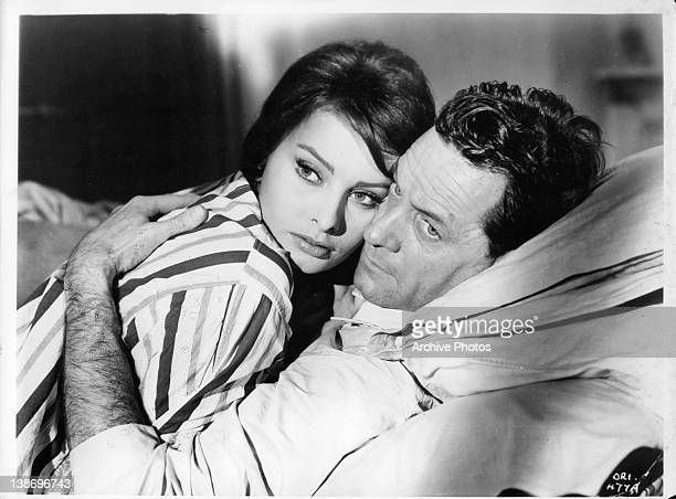 Sophia Loren in bed with William Holden in a scene from the film 'The Key' 1958