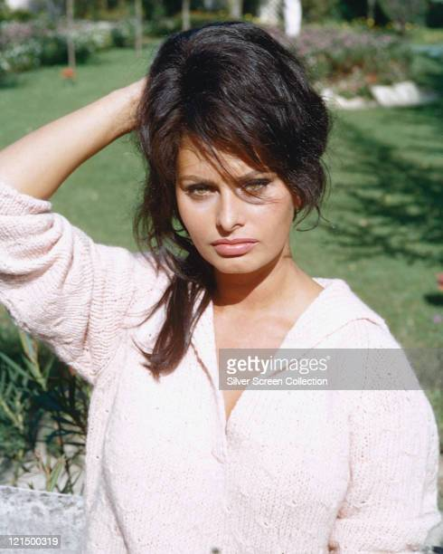 Sophia Loren Italian actress posing outdoors with her hand behind her head holding her hair in place circa 1960