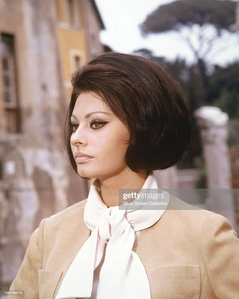 Sophia Loren Italian actress wearing a beige jacket with a white scarf tied around her neck circa 1960