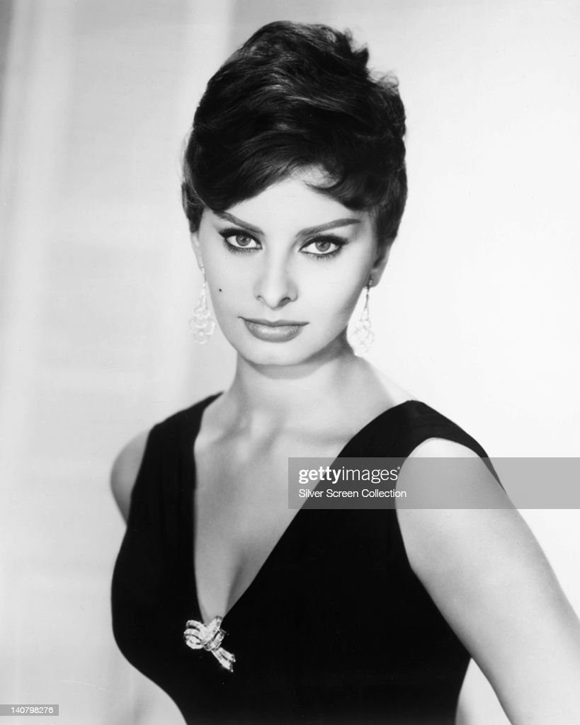 Sophia Loren Italian actress wearing a sleeveless top with a plunging neckline in a studio portrait against a white background circa 1950