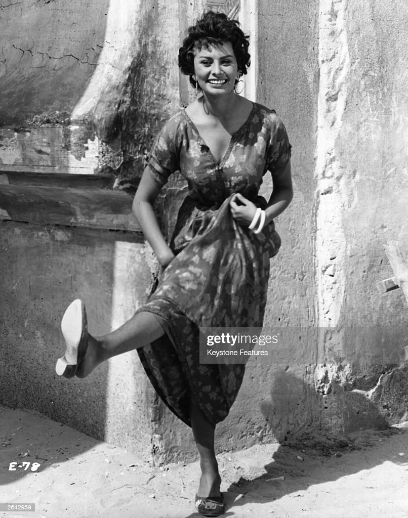 Sophia Loren the Italian actress lets her hair down between scenes for the film 'Legend of the Lost' in which she costarred with John Wayne Original...
