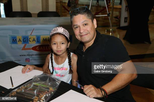 Sophia Ramirez and her father artist John Ramirez attend a preview event at the Magical Memories Fine Art Gallery inside The Forum Shops At Caesars...