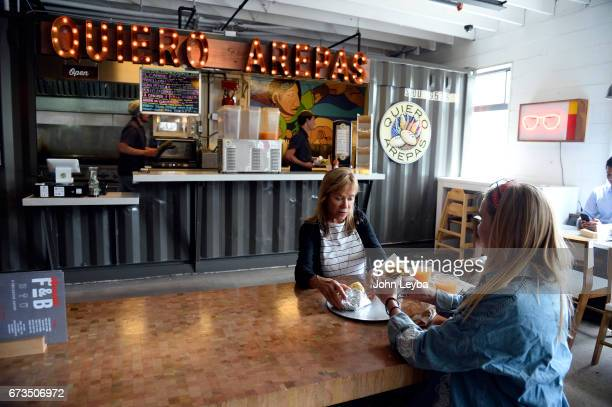 Sophia Sharp enjoys her lunch with her daughter Jeannette Sharp Oakes at Quiero Arepas at the Avanti food hall on April 26 2017 There are 5...