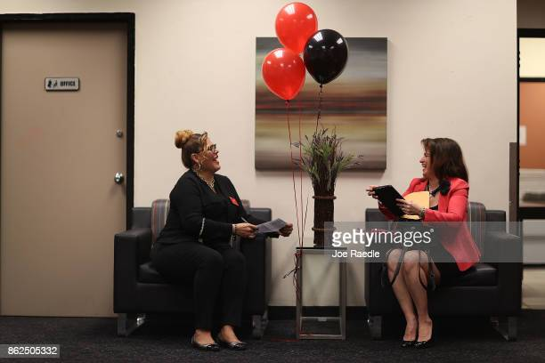 Sophia Wesley a JC Penny supervisor for appliances speaks with Janice Montalvo as she prepares to be interviewed for a seasonal job during a job fair...