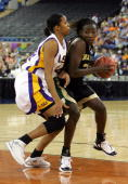 Sophia Young of the Baylor Lady Bears is defended by Wendlyn Jones of the Louisiana State Lady Tigers in the Semifinal game of the Women's NCAA...