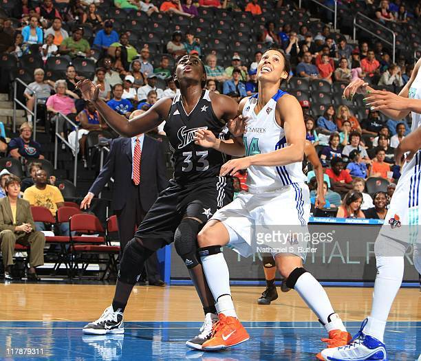 Sophia Young of the San Antonio Silver Stars boxes out against Nicole Powell of the New York Liberty during a game on July 1 2011 at the Prudential...