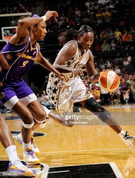 Sophia Young of the San Antonio Silver Stars drives against Lisa Leslie of the Los Angeles Sparks in Game Two of the Western Conference Finals during...