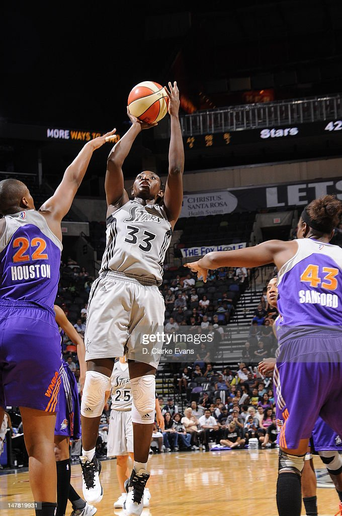 Sophia Young of the San Antonio Silver Stars shoots against Charde Houston and Nakia Sanford of the Phoenix Mercury at the ATT Center on July 3 2012...