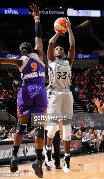 Sophia Young of the San Antonio Silver Stars shoots against Marie FerdinandHarris of the Phoenix Mercury at the ATT Center on September 1 2011 in San...
