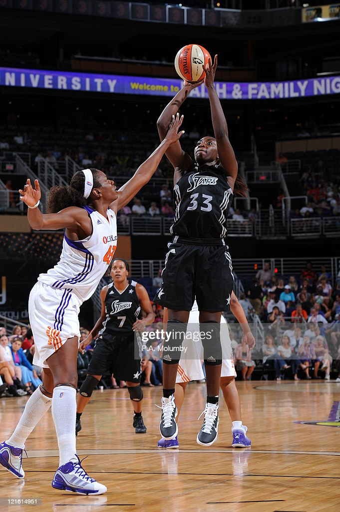 Sophia Young of the San Antonio Silver Stars shoots against Nakia Sanford of the Phoenix Mercury on August 20 2011 at US Airways Center in Phoenix...