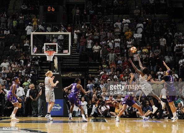 Sophia Young of the San Antonio Silver Stars shoots the winning basket against Jessica Moore and Candace Parker of the Los Angeles Sparks in Game Two...