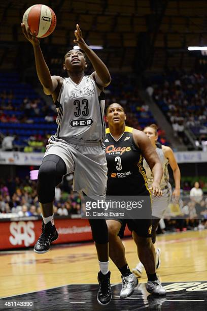 Sophia YoungMalcolm of the San Antonio Stars goes up for a shot against the Tulsa Shock at the Freeman Coliseum in San Antonio TX on July 17 2015 in...