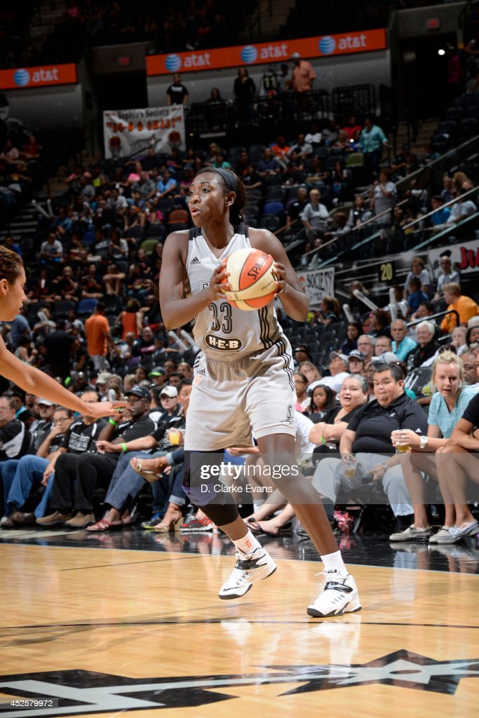 Sophia Young-Malcolm #33 of the San Antonio Stars handles the ball against the Seattle Storm at the AT&T Center on July 11, 2014 in San Antonio, Texas.