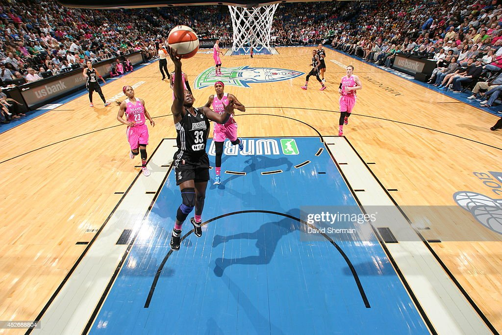 Sophia Young-Malcom #33 of the San Antonio Stars goes for the shot against the Minnesota Lynx during the WNBA game on July 25, 2014 at Target Center in Minneapolis, Minnesota.
