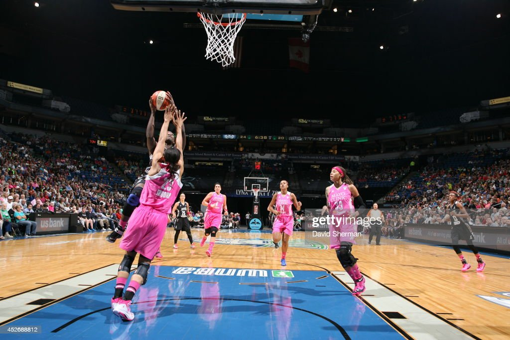 Sophia Young-Malcom #33 of the San Antonio Stars goes for the shot against Maya Moore #23 of the Minnesota Lynx during the WNBA game on July 25, 2014 at Target Center in Minneapolis, Minnesota.