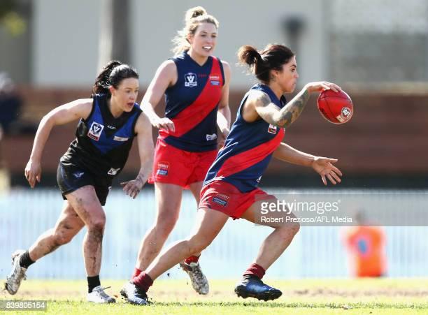 Sophie Abbatangelo of Diamond Creek kicks during the round 14 Women's VFL match between Melbourne University and Diamond Creek at Melbourne...