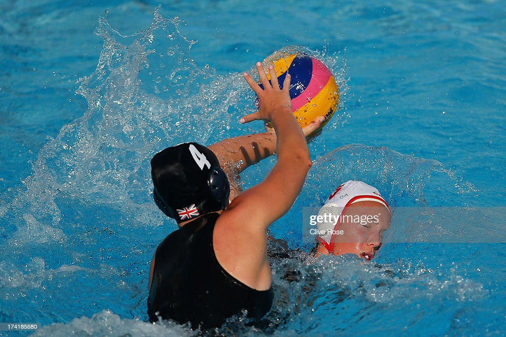 Sophie Baron le Salle of Canada is attacked by Ciara Gibson-Bryne of Great Britain during the Women's Water Polo first preliminary round match between Canada and Great Britain during Day Two of the 15th FINA World Championships at Piscines Bernat Picornell on July 21, 2013 in Barcelona, Spain.