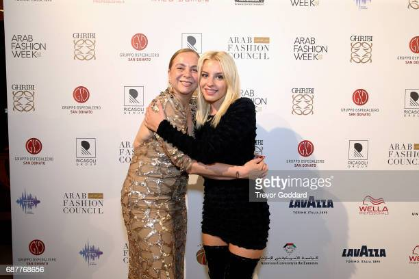 Sophie Beem poses with Jessica Garnetti At the Arab Fashion Week Ready Couture Resort 2018 Gala Dinner on May 202017 at Armani Hotel in Dubai United...