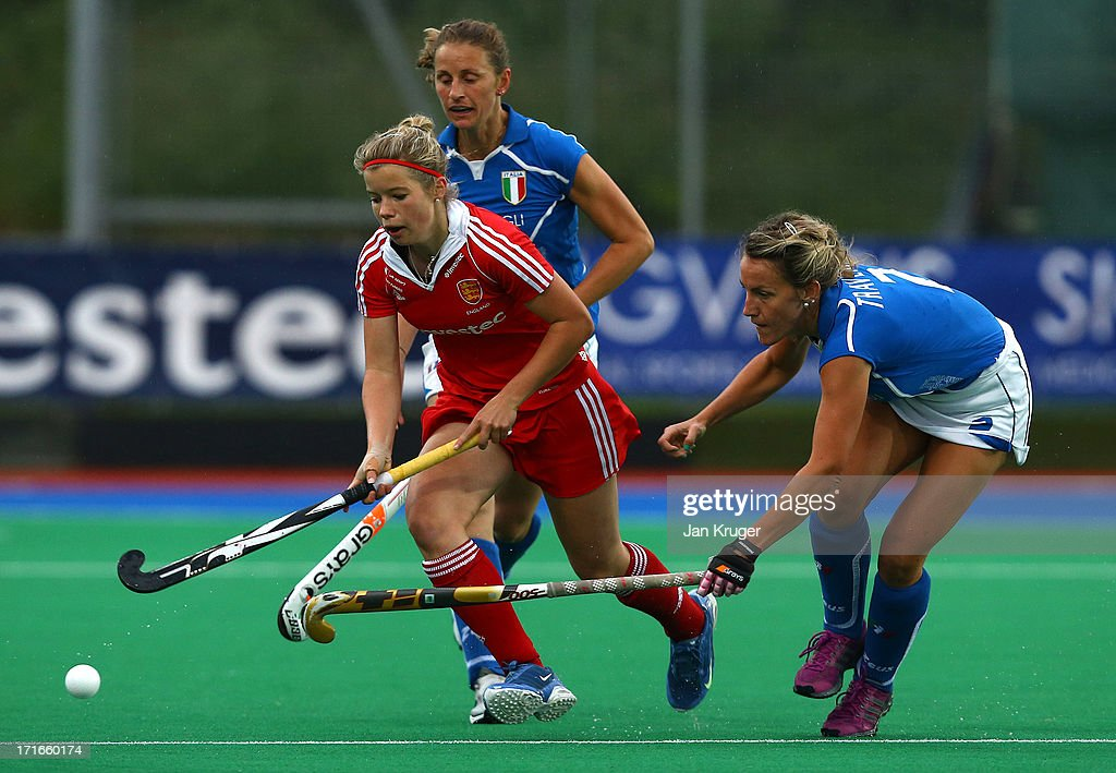 Sophie Bray (L) of England battles with Celina Traverso of Italy during the Investec Hockey World League quarterfinal match between England and Italy at the Quintin Hogg Memorial Sports Grounds on June 27, 2013 in London, England.