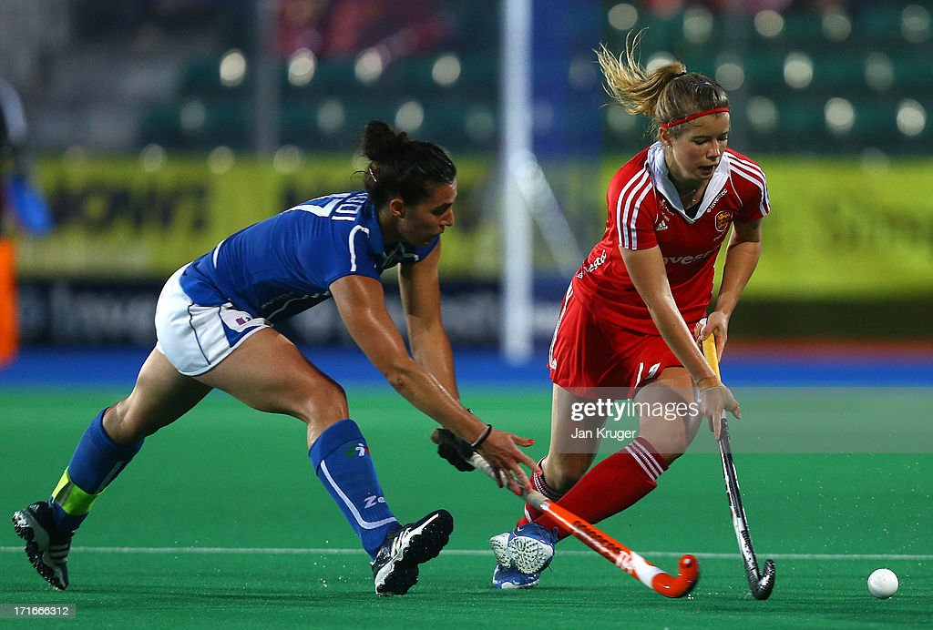 Sophie Bray of England battles with Chiara Tiddi of Italy during the Investec Hockey World League quarterfinal match between England and Italy at the Quintin Hogg Memorial Sports Grounds on June 27, 2013 in London, England.