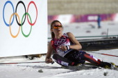 US Sophie Caldwell sits on the snow at the finish in the Women's CrossCountry Skiing 10km Classic at the Laura CrossCountry and Biathlon Center...