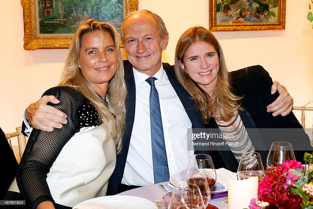 Sophie Cauvin, CEO of L'Oreal <a gi-track='captionPersonalityLinkClicked' href=/galleries/search?phrase=Jean-Paul+Agon&family=editorial&specificpeople=675160 ng-click='$event.stopPropagation()'>Jean-Paul Agon</a> and his Companion Sophie Scheidecker attend the 'Diner des Amis du Musee d'Art Moderne' at Musee d'Art Moderne on October 21, 2014 in Paris, France.