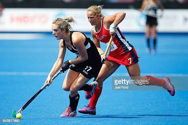 Sophie Cocks of New Zealand carries the ball past Kelsey Kolojejchick of the USA during the FIH Women's Hockey Champions Trophy 2016 match between...