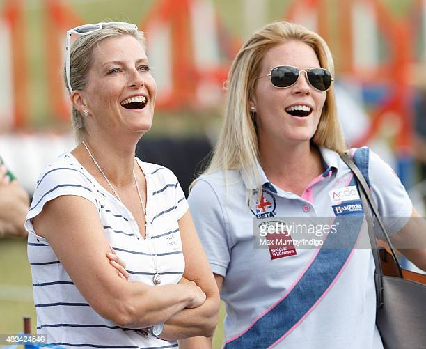Sophie Countess of Wessex and Autumn Phillips watch their children play on an inflatable slide as they attend day 2 of the Festival of British...