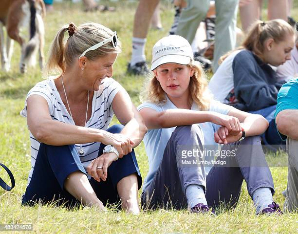 Sophie Countess of Wessex and daughter Lady Louise Windsor sit on the grass to watch the cross country phase of the competition as they attend day 2...