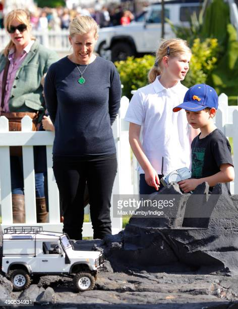 Sophie Countess of Wessex and Lady Lousie Windsor looks on as James Viscount Severn plays with a radio controlled Land Rover as they attend day 1 of...