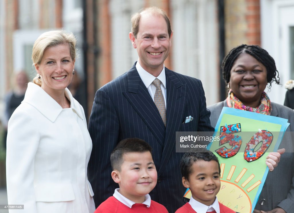 Sophie, Countess of Wessex and Prince Edward, Earl of Wessex pose during an official visit on the Earl's 50th Birthday at Robert Browning Primary School on March 10, 2014 in London, England.