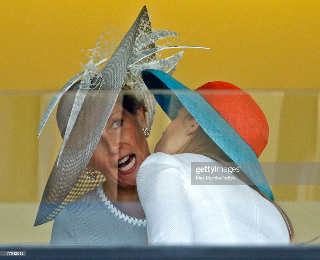 Sophie, Countess of Wessex and Princess Beatrice attempt to kiss hello as they attend day 3, Ladies Day, of Royal Ascot at Ascot Racecourse on June 18, 2015 in Ascot, England.
