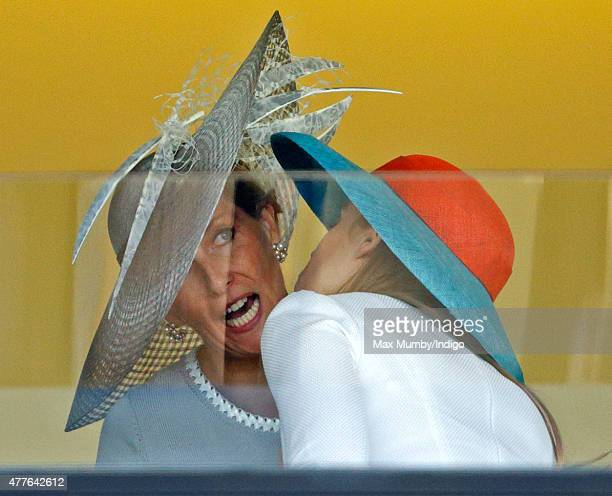 Sophie Countess of Wessex and Princess Beatrice attempt to kiss hello as they attend day 3 Ladies Day of Royal Ascot at Ascot Racecourse on June 18...