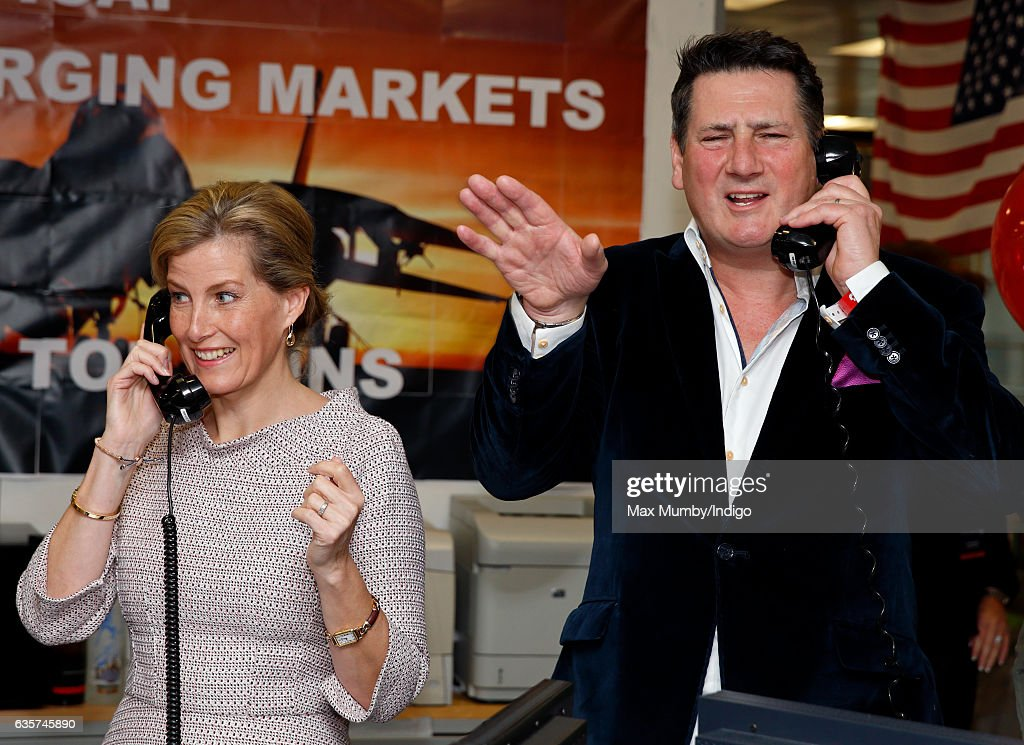Sophie, Countess of Wessex and Tony Hadley conduct a trade via telephone as they attend ICAP's 24th annual charity trading day in aid of Sentebale at ICAP on December 7, 2016 in London, England. The Sentebale charity, of which Prince Harry is Patron, supports orphans and vulnerable children in Southern Africa.