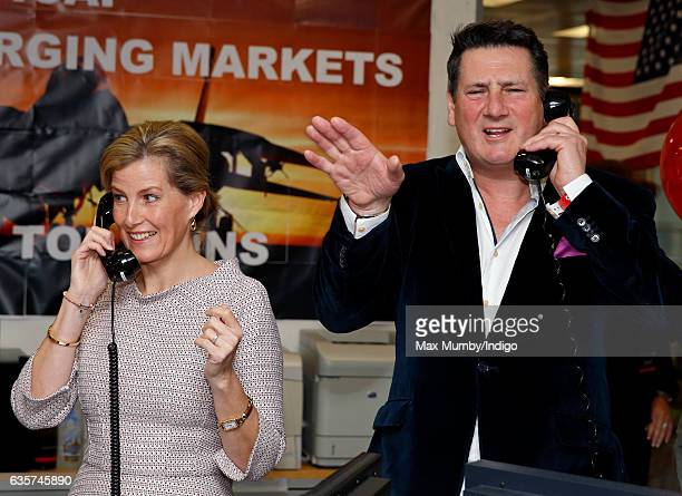 Sophie Countess of Wessex and Tony Hadley conduct a trade via telephone as they attend ICAP's 24th annual charity trading day in aid of Sentebale at...