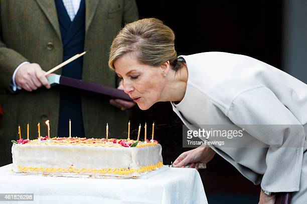 Sophie Countess of Wessex blows out candles on a birthday cake during a visit to the Tomorrow's People Social Enterprises at St Anselm's Church on...
