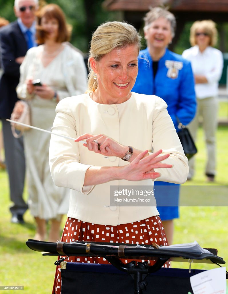Sophie, Countess of Wessex conducts the Cobham Band as she visits the Riverhill Regeneration Project on July 9, 2014 in Cobham, England.