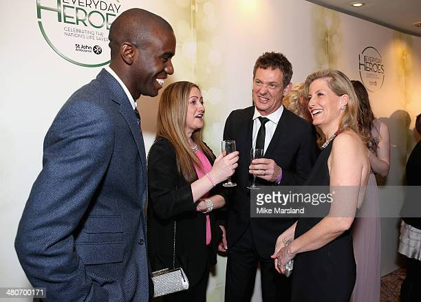 Sophie Countess of Wessex greets Fabrice Muamba Amelia Wright and Matthew Wright as they attend the starstudded St John Ambulance Everyday Heroes...