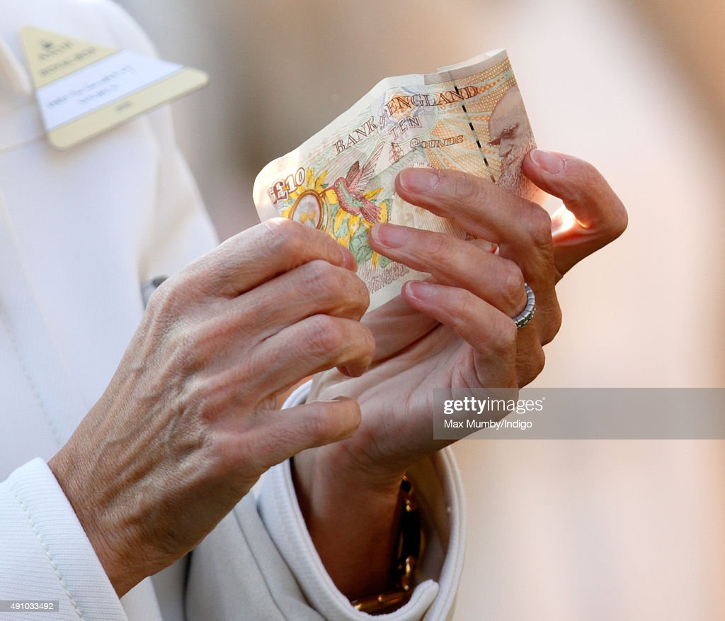 Sophie Countess of Wessex holds a ten pound note as she attends the Autumn Racing CAMRA Beer Festival meet at Ascot Racecourse on October 2 2015 in...