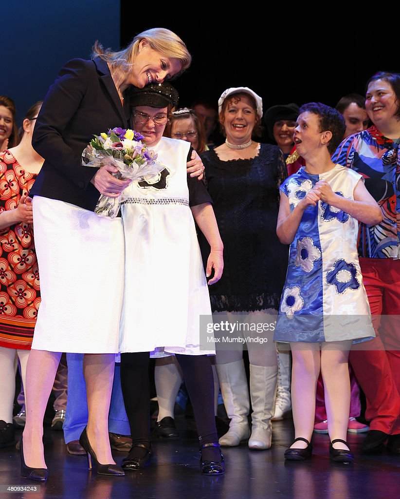 Sophie, Countess of Wessex hugs a member of the cast after watching a performance during a visit to Shanklin Theatre on a day of engagements on the Isle of Wight on March 27, 2014 in Shanklin, England.