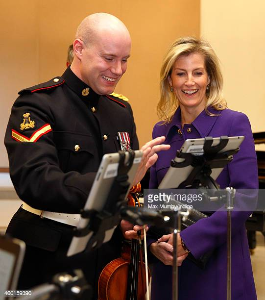Sophie Countess of Wessex is shown how musicians use iPads rather than sheet music during a visit to The Countess of Wessex's String Orchestra at The...