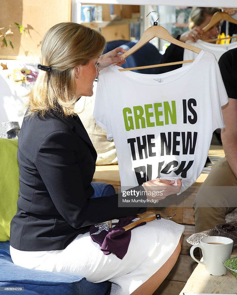 Sophie, Countess of Wessex looks at t-shirts made of bamboo as she visits Rapanui, a sustainable fashion label, during a day of engagements on the Isle of Wight on March 27, 2014 in Sandown, England.