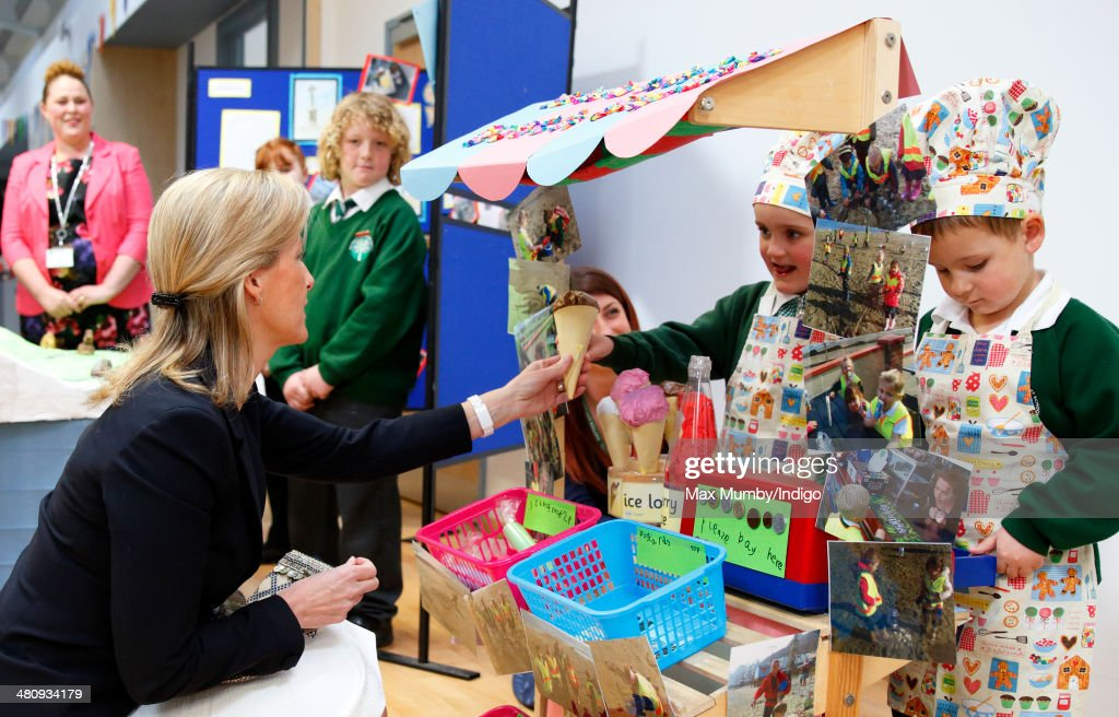 Sophie, Countess of Wessex meets school children with a role play 'beach cafe' stall as she visits the Gatten and Lake Primary School during a day of engagements on the Isle of Wight on March 27, 2014 in Shanklin, England.