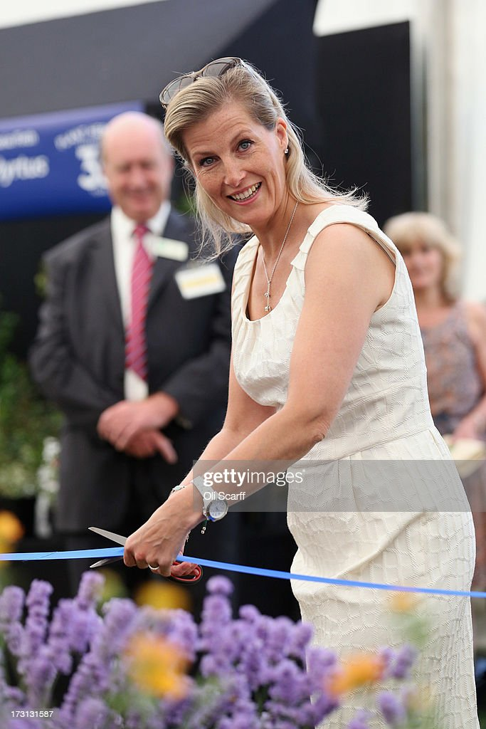 Sophie, Countess of Wessex, opens the 'Plant Heritage Marquee' at the Hampton Court Palace Flower Show on July 8, 2013 in London, England. Hampton Court Palace Flower Show opens to the public tomorrow and runs until July 14, 2013. It is the world's largest flower show with over 600 exhibitors spread over 34 acres.